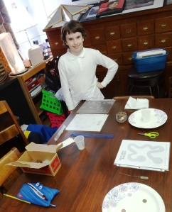 Carter explains his science experiment.