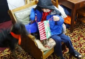 Ian looks for RJ's gift.