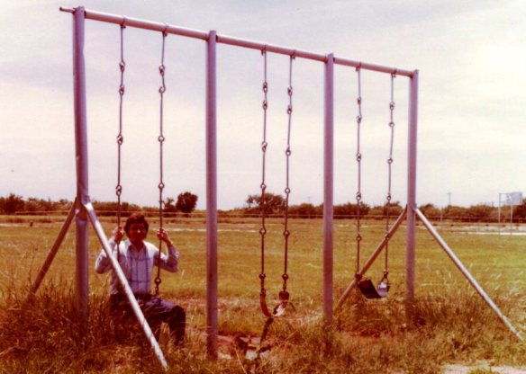 Yes, that's me on the swing I loved at South Elementary (the school was gone but the swing still there).