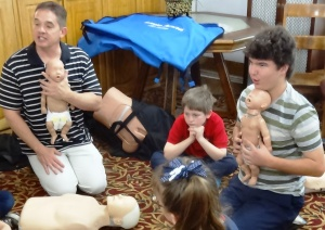 Chris Leech with Premier Safety demonstrates CPR for babies.